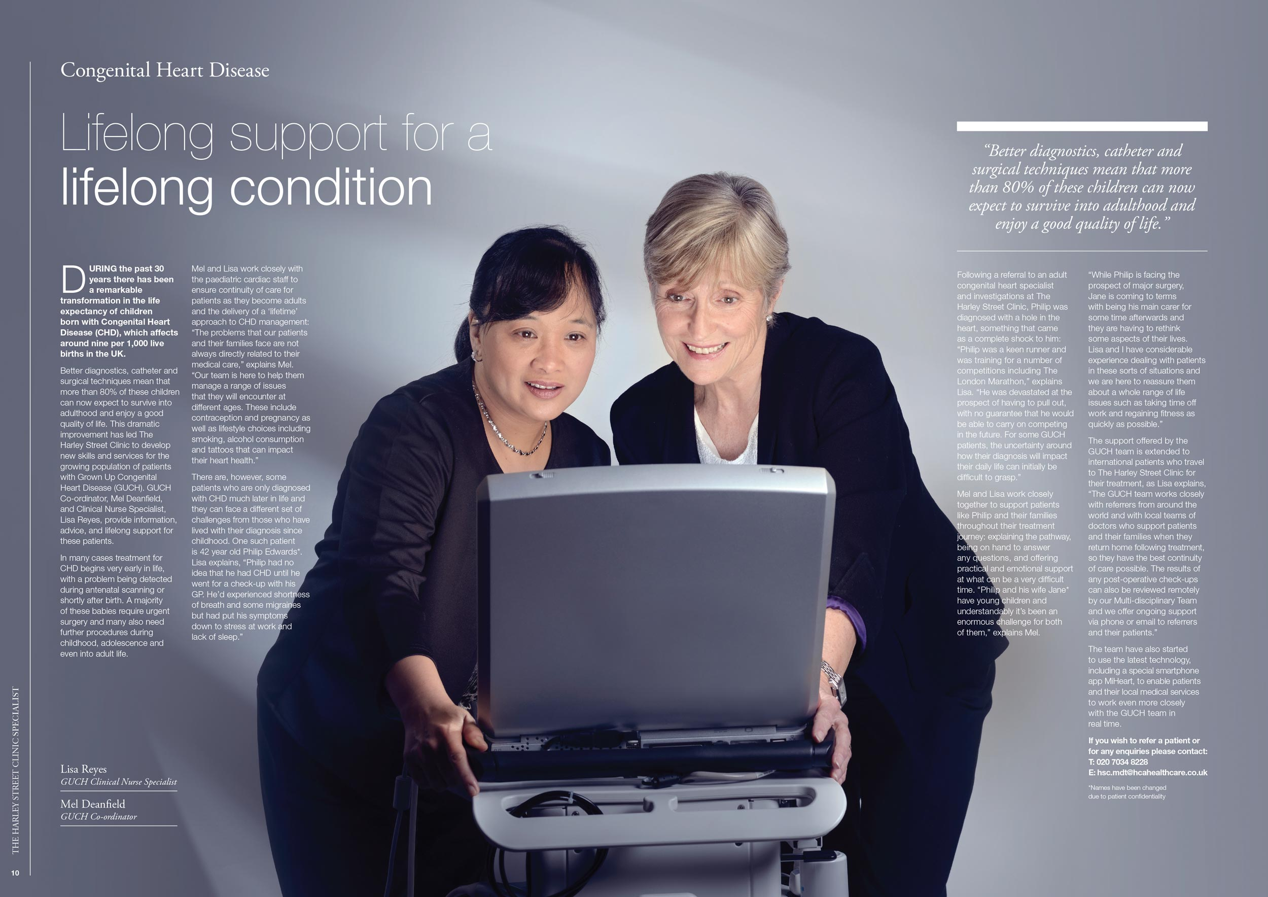 Two healthcare consultants look at monitor