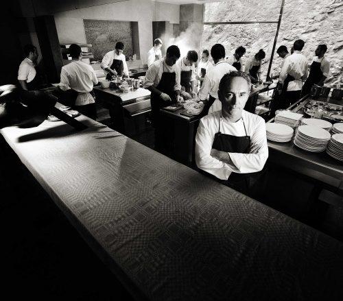 Ferran Adria inside the kitchen at El Bulli restaurant with chefs behind